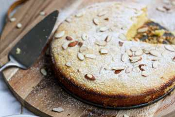 citrus almond ricotta cake on a wooden board