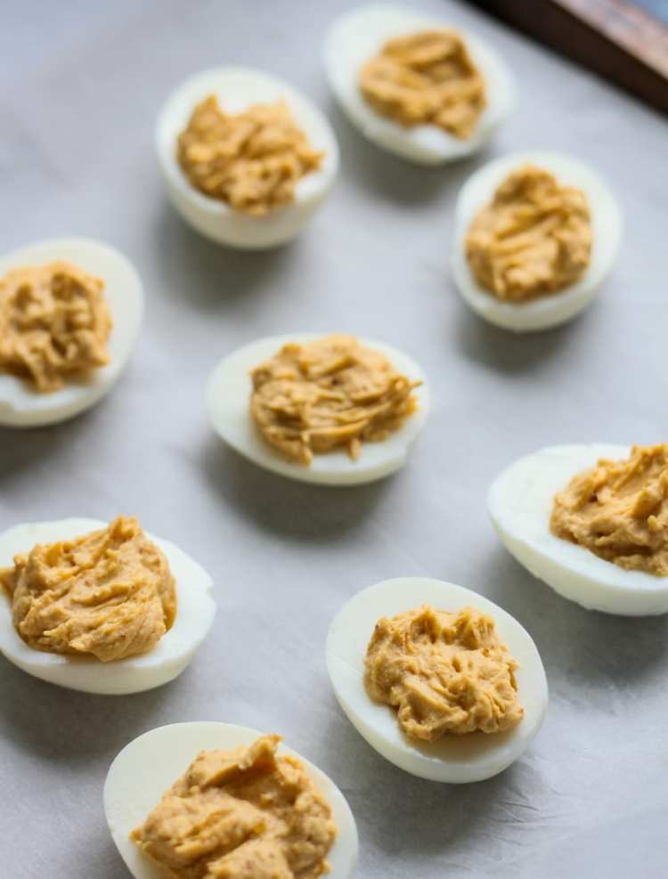 undecorated buffalo bacon deviled eggs on a piece of parchment