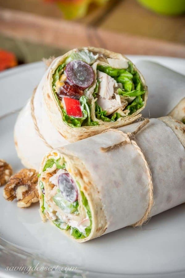 Turkey Waldorf Wraps tied up with parchment paper