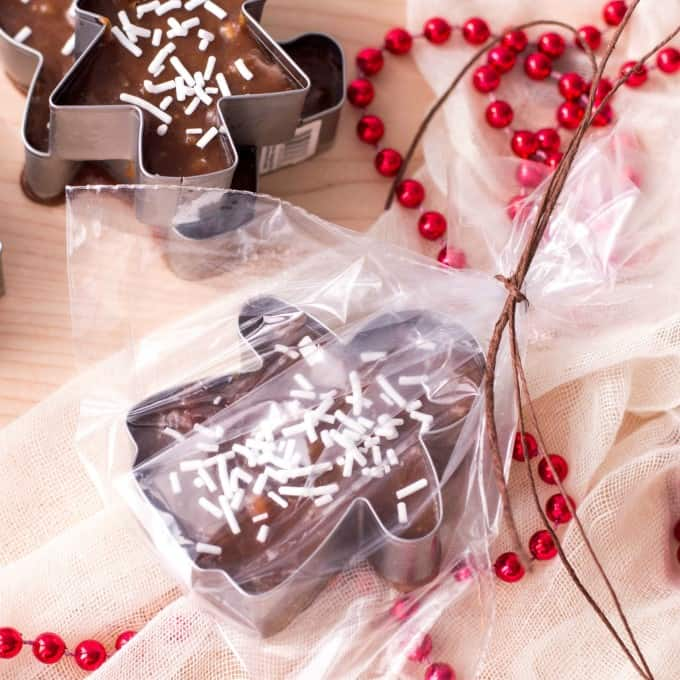 Cookie Cutter Christmas Fudge warpped in cello laying down.