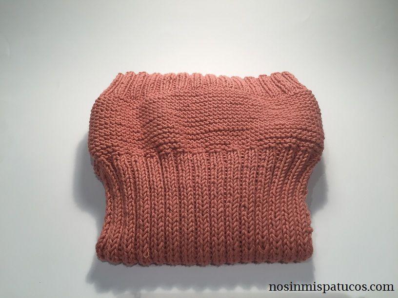 cubre pañal sencillo tejido a mano con dos agujas.