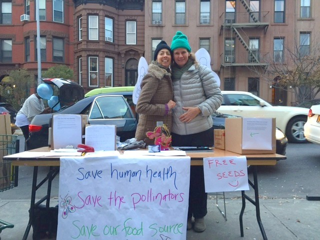 Athena Malloy and Carolina Kroon collect signatures on THIS petition (sign it!) outside the Park Slope Food Coop on Halloween.