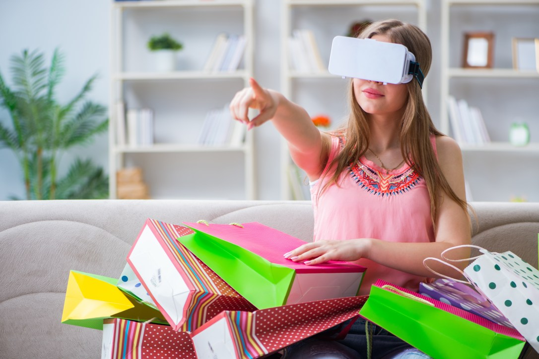 Young woman doing shopping with virtual reality glasses