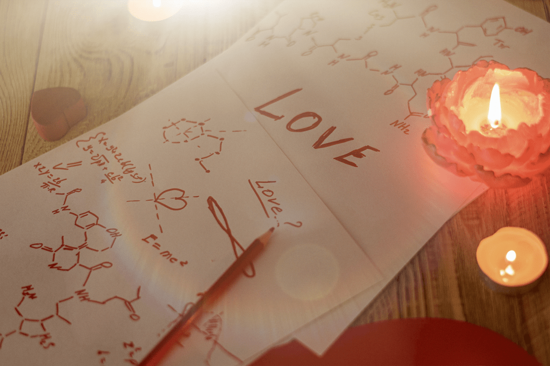 Formula love concept. Research, search for an answer to the question what is love. Sheets of paper with chemical formulas of hormones by candlelight