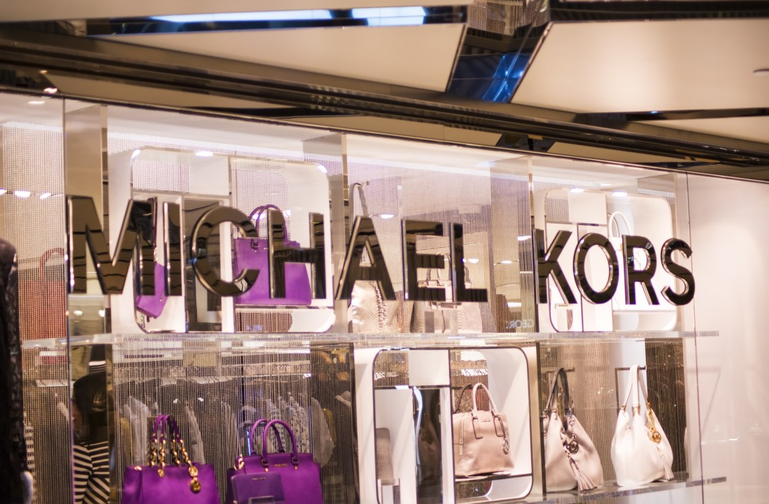 View at Michael Kors shop. Michael Kors  is a New York City-based fashion designer widely known for designing classic American sportswear for women.