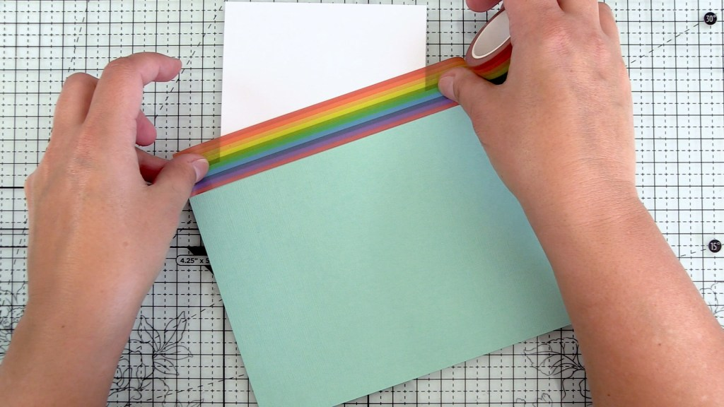 Adhere cardstock scrap with Narrow Rainbow Washi Tape
