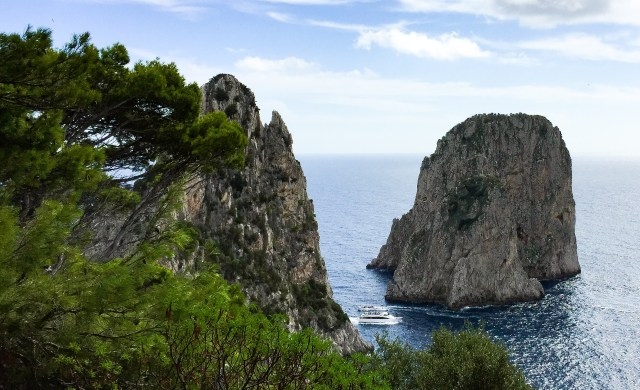 View of the Faraglioni from the trail to the Punta Tragara viewpoint in Capri, Italy