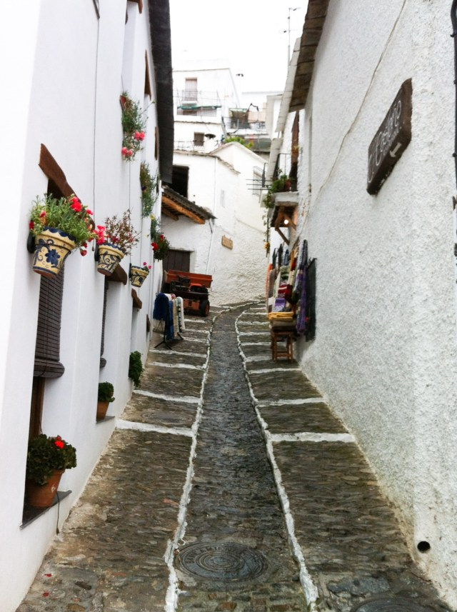 Walking uphill in the white village of Pampaneira in Andalusia Spain