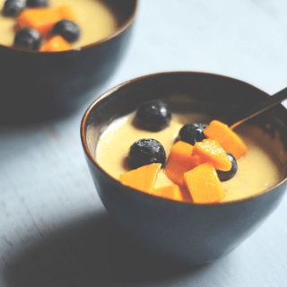 Saffron Phirni with mango and blueberries (rice pudding)