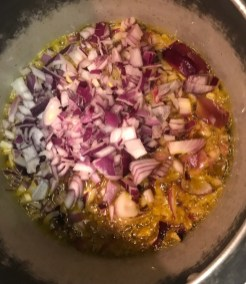 fry onions goat curry