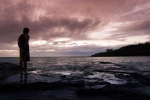 Man watching a marine sunset