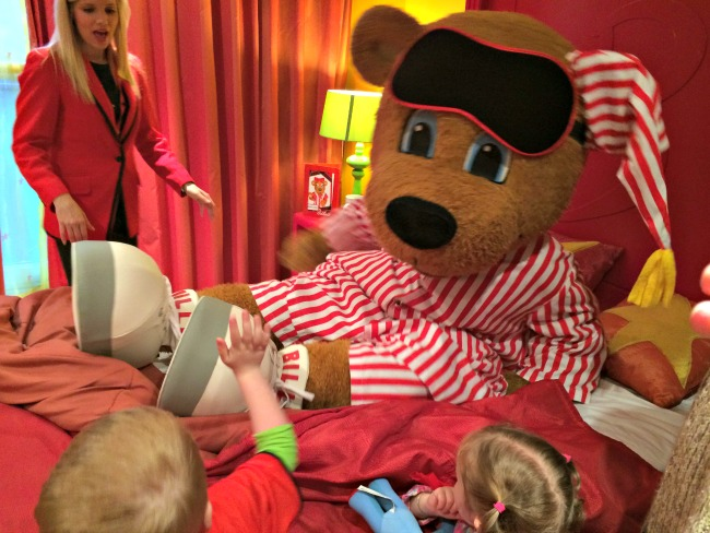 Tucking Billy Bear into bed at Butlins
