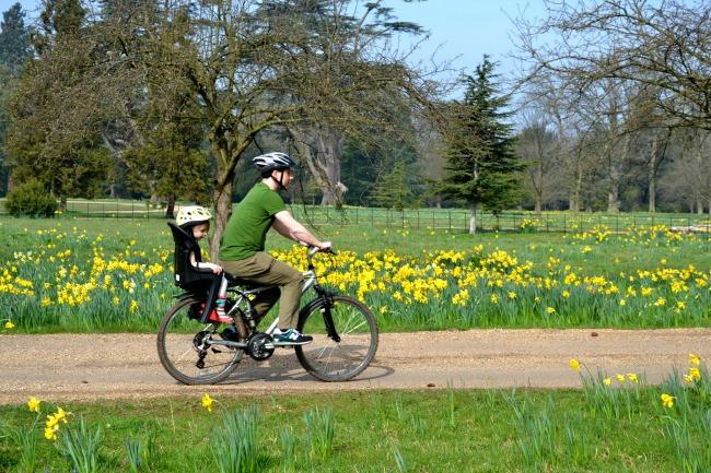 family-on-bike-in-spring