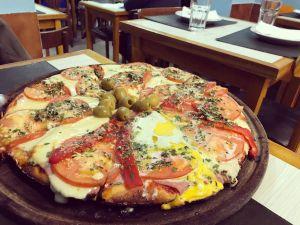 Pizza en El Cuartito