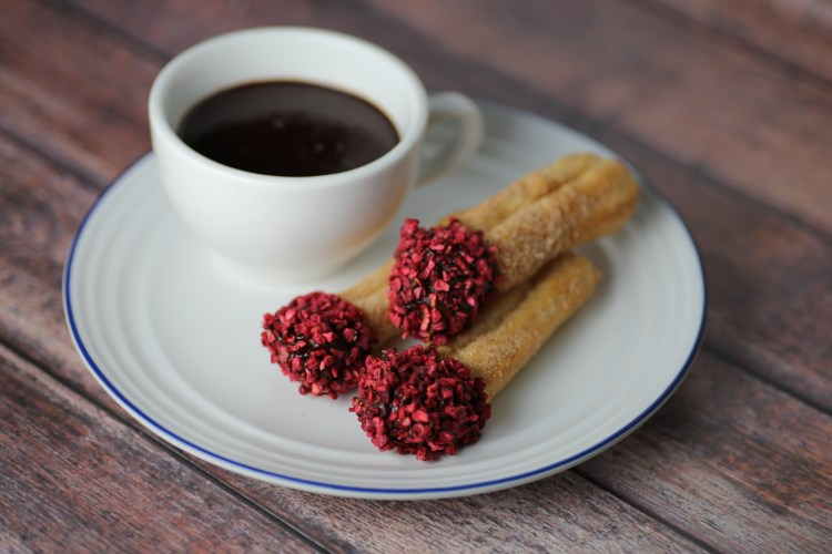 baked churros and rasberries