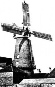 Coatham Mill with men working on the sails