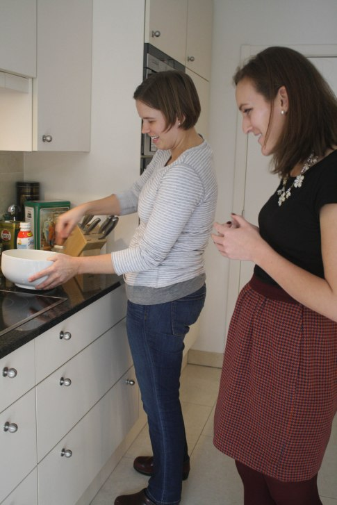 Courtney teaching Katy how to whisk properly.