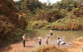 African Trails group taking a bath in a river on Australia Day, Cameroon (2012-01-26)