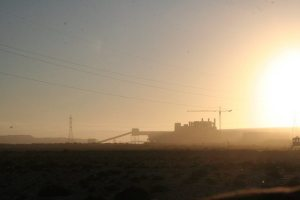 Factory in the distance at sunset in Western Sahara, Morocco (2011-11)