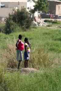 Women looking in Angola (2012-02)