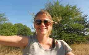 Carola hitchhiking near Lake Kariba in Zimbabwe (2012-04-10)