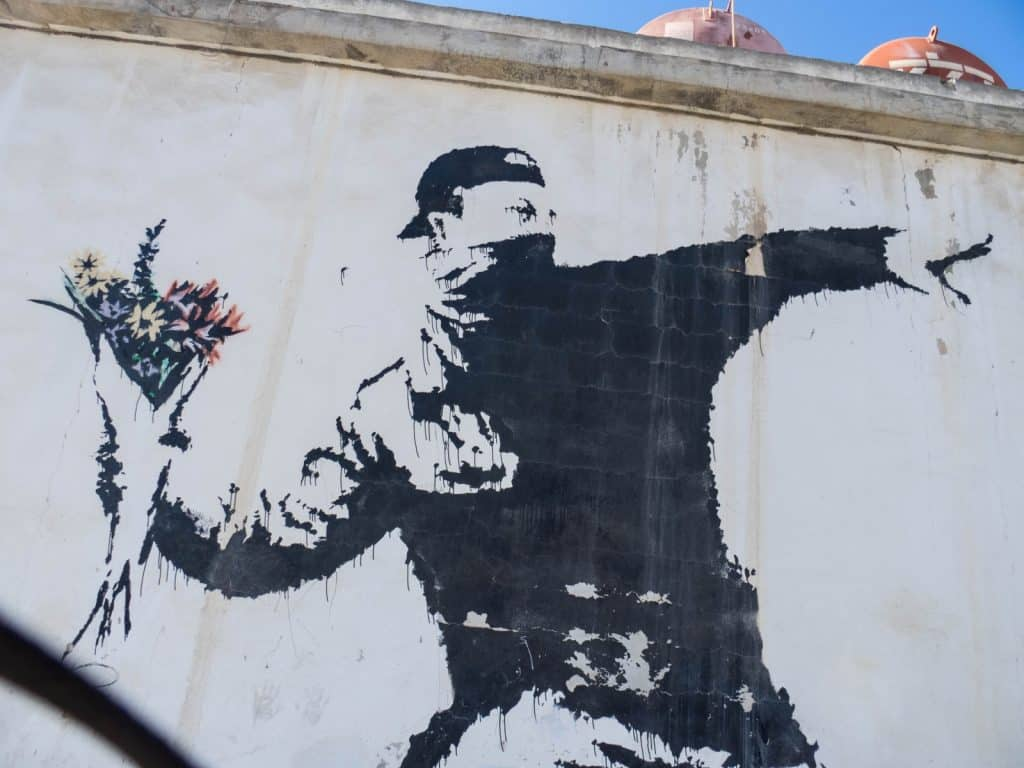 Banksy: Protester Throwing Flowers, Bethlehem, Palestine (2017-01-11)