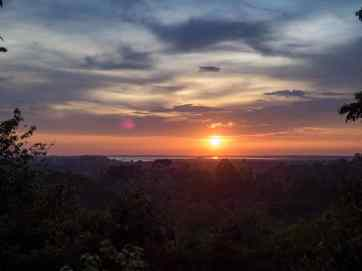 Phnom Bakheng sunset over West Mebon Baray, Siem Reap, Cambodia (2017-04-21)