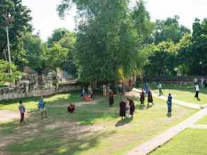 Monks taking pictures in Mae Nu Oak Kyaung (Brick Monastery), Innwa, Mandalay, Myanmar (2