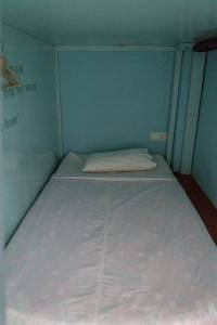 Pod-style dorm bed at Song of Travel hostel, Inle Lake, Myanmar (2017-10)