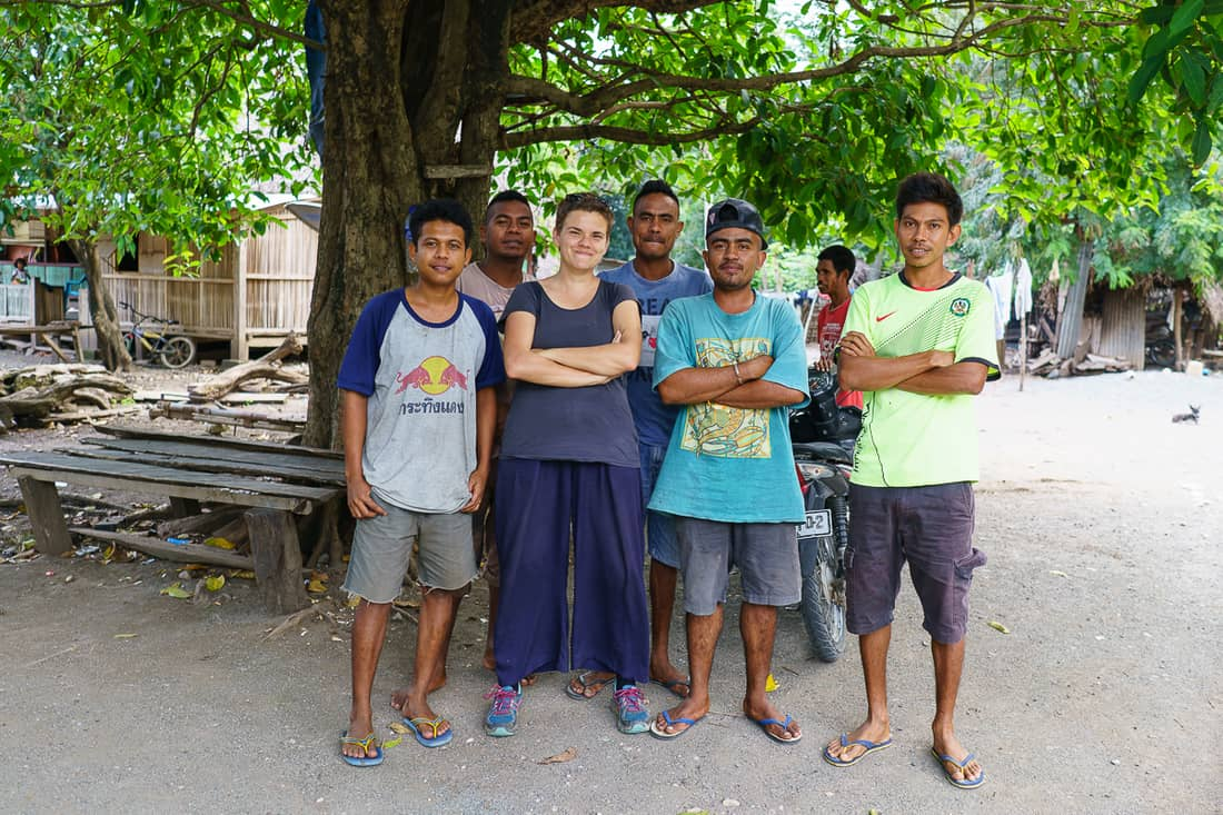 Carola posing with local young men at Suai Loro village, East Timor
