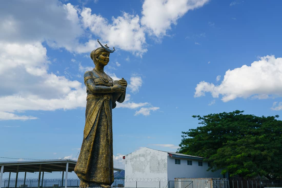Statue of a woman in traditional clothes, Pante Macassar, Oecusse, East Timor