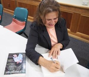 Samilya signing book