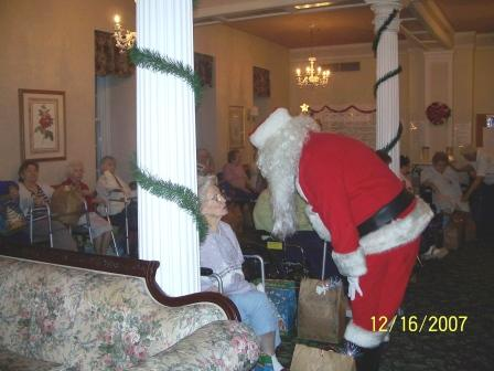 Santa Gives out homemade quilts donated by ladies of the community.