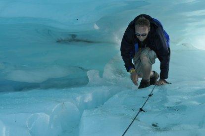Bill crawling through an ice tunnel