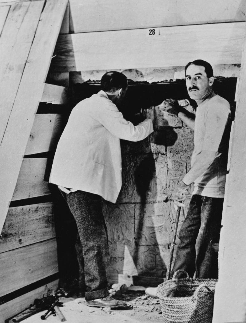 Howard Carter and a colleague excavating a tomb in the Valley of the Kings, Egypt, 1922. Artist: Harry Burton