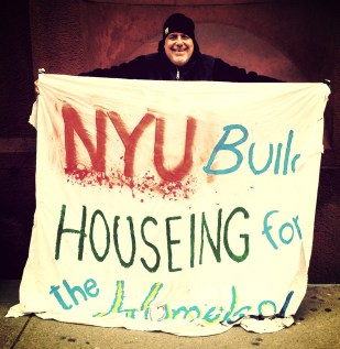 John Holds NYU sign for Housing