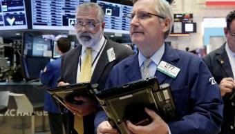 Inversionistas de la Bolsa de Nueva York durante la apertura de sesión (AP)