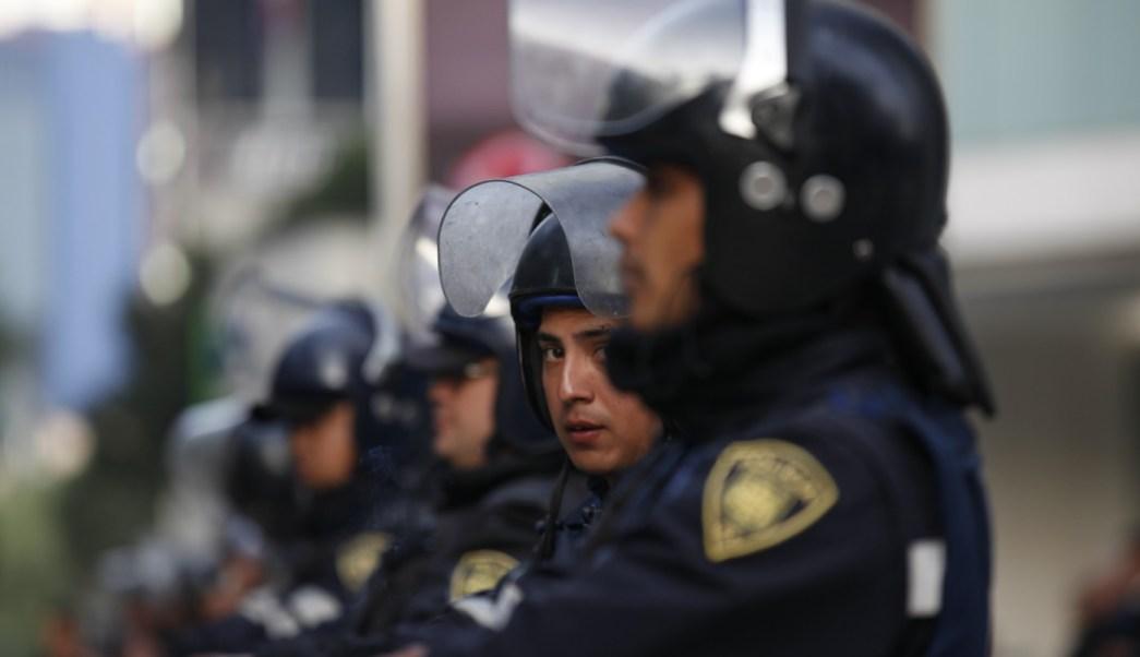 Elementos de la policía capitalina reforzarán la seguridad en el clásico joven (AP/archivo)