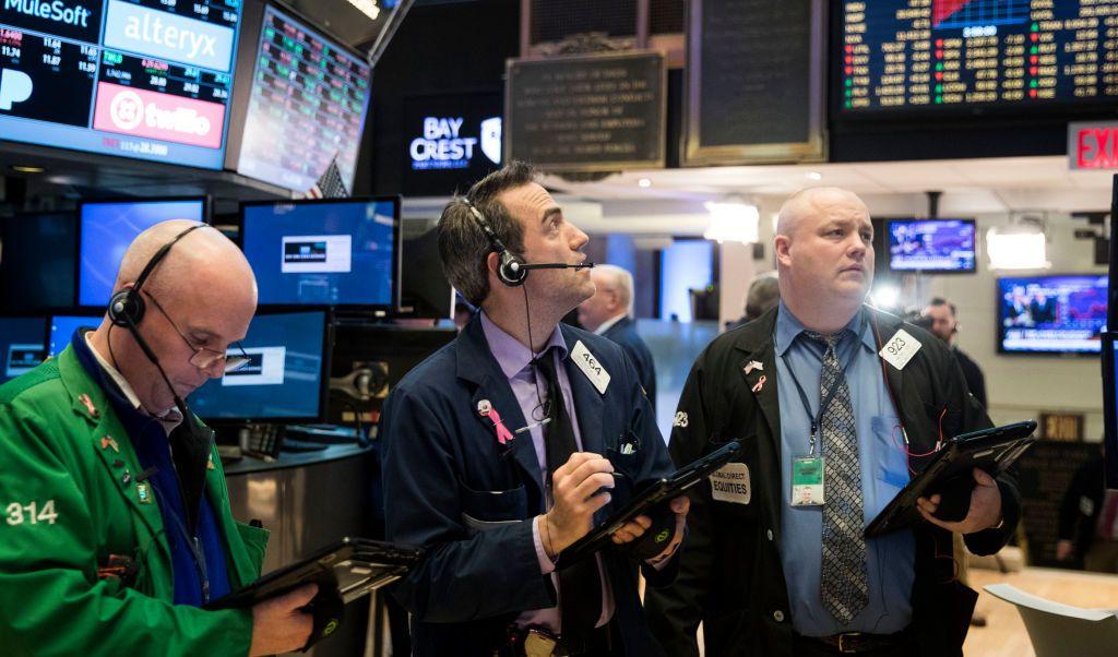 Corredores de bolsa de Wall Street.