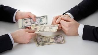 El Banco de México realizó seis subastas de cobertura de dólares; ofreció mil millones de dólares, pero la demanda fue de 2,072 mdd. (Getty Images)
