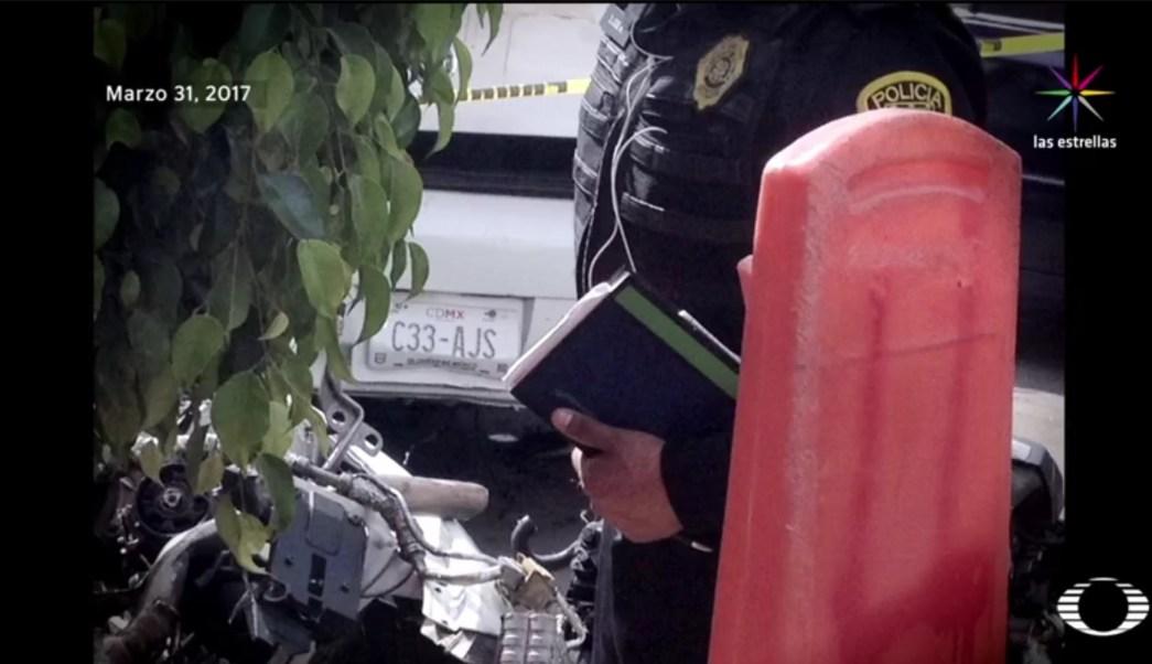 La póliza de seguro no corresponde a la placa del automóvil BMW, matrícula C33-AJS. (Noticieros Televisa)