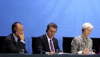 Jim Yong Kim, presidente del Banco Mundial; Roberto Azevedo, presidente de la OMC, y Christine Lagarde, directora gerente del FMI. (Getty Images)