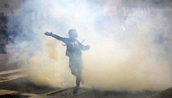 Policía de venezuela, gas lacrimógeno, opositores venezolanos, Caracas