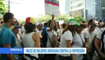 Diputadas opositoras, encabezan marcha, contra represión en Venezuela, miles de mujeres