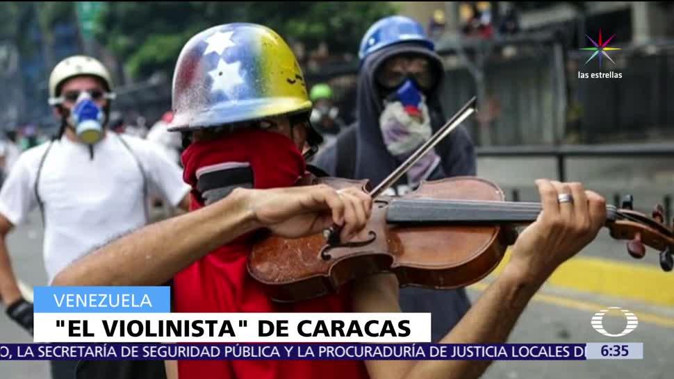 joven, tocar violín, militar, manifestación antigubernamental, Venezuela