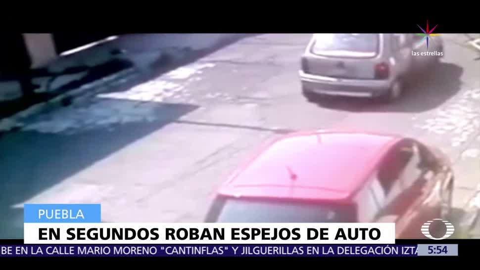 Captan en video, tres hombres, robando, espejos laterales de auto