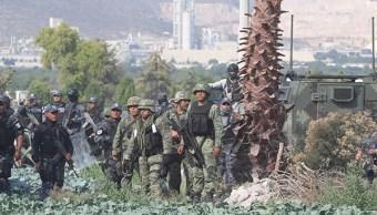 Personal militar y policía federal en Puebla. (Reuters)