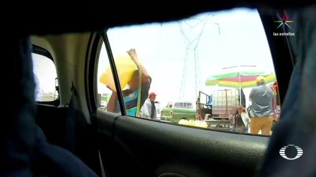 Huachicol, huachicoleros, gasolina robada, puebla, central de abasto, litro