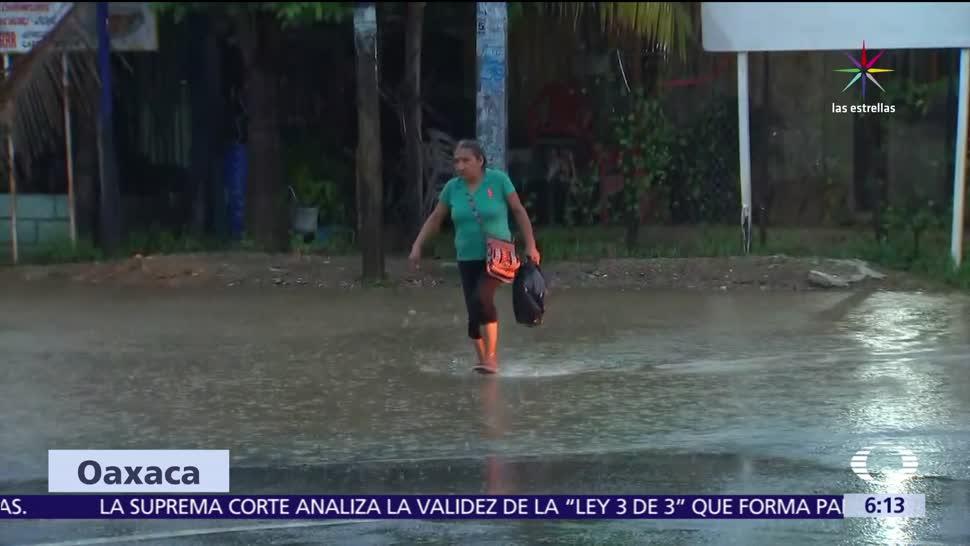 alerta por las lluvias, depresión tropical Calvin, Oaxaca, aludes, desbordamiento de ríos