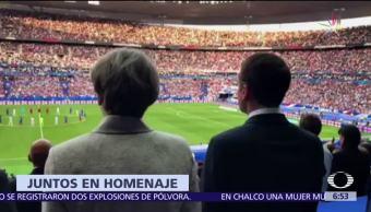 Theresa May, Emmanuel Macron, homenaje a las víctimas, terrorismo, partido amistoso de futbol